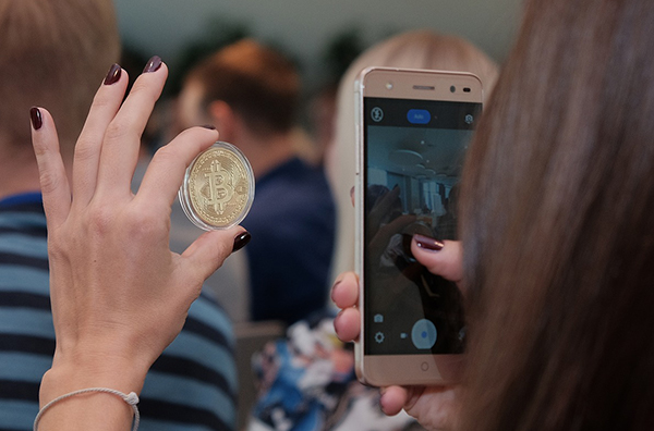Cryptocurrencies - taking photo of a bitcoin